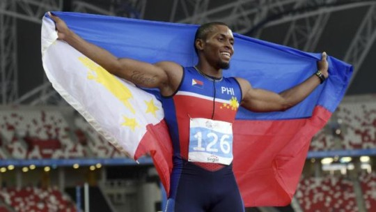 Eric Shauwn Cray of the Philippines celebrates after winning the men's 100-meter final at the SEA Games in Singapore Tuesday, June 9, 2015. (AP Photo/Joseph Nair)