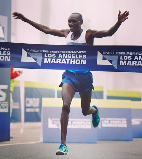 Skechers GO Elite athlete Weldon Kirui wins the race with a finish time of 2:13:06