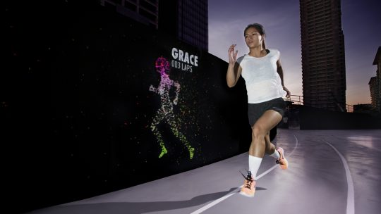 Nike Run Club Coach Ian Banzon outpacing his avatar at the Unlimited Stadium