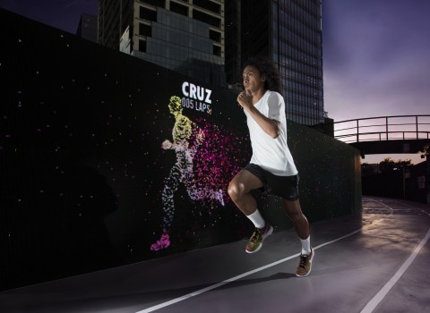 Nike Run Club Coach Rio dela Cruz outpacing his avatar at the Unlimited Stadium