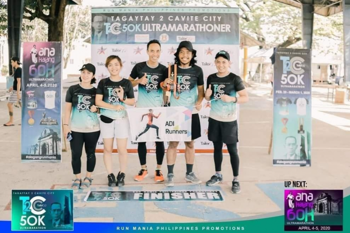 Photo of Ruby Aranas posing for a picture with her running group
